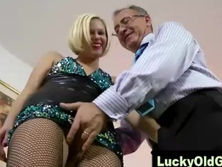 Lucky old guy plays with blonde in...