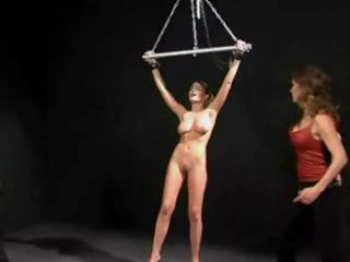 Busty Brunette Myra Gets Strung Up And Her Titties Pinched And Smacked