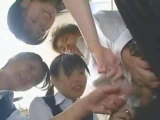 Japanese Schoolgirls Are Teasing And Playing With Guy's Cock