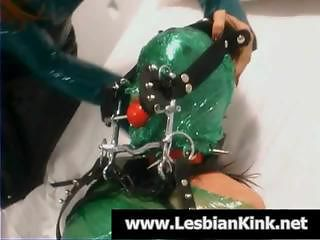 Redhead mistress is tying up and gagging her slave in wrap