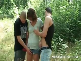 Outdoor 3some With Appealing Milf