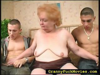 Grandma Sucking On Two Hard Dicks