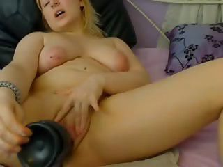 Blonde Tries Huge Dildo On Webcam